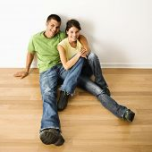 Couple on new hardwood floor